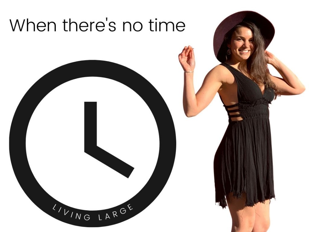 Woman in black dress standing next to a clock