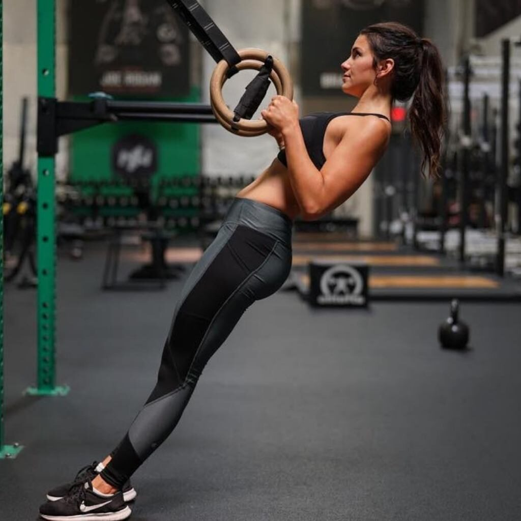 Strong woman doing rows Onnit Gym