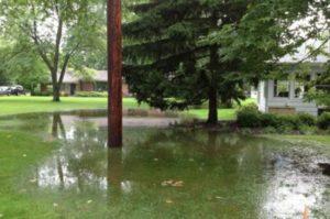 Flooded yard in Dallas Fort Worth French Drain Installation