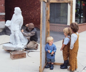 Stone carver working outside Studio Place Arts in Barre, VT