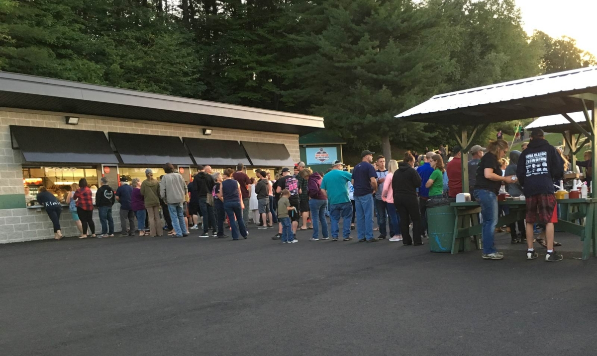 Crowds buying food at Thunder Road Speedbowl in Barre Vermont