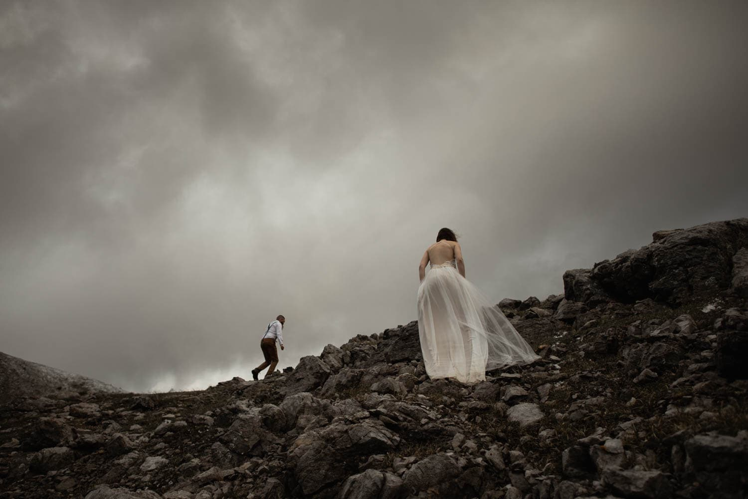 Bride and Groom Climbing Mountain