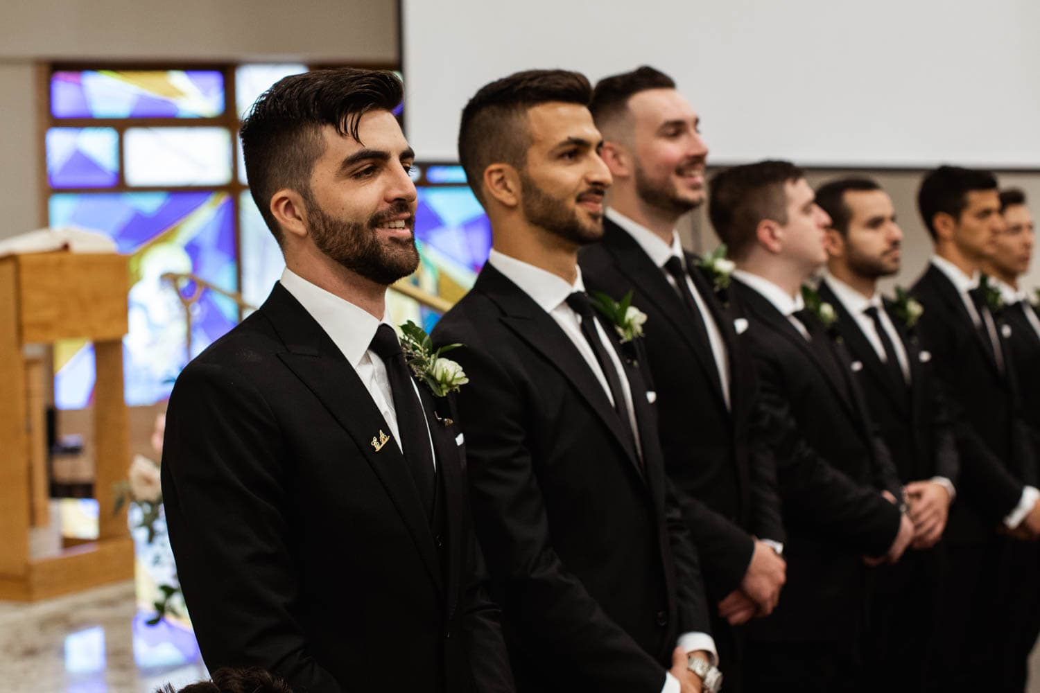 groomsmen at the alter