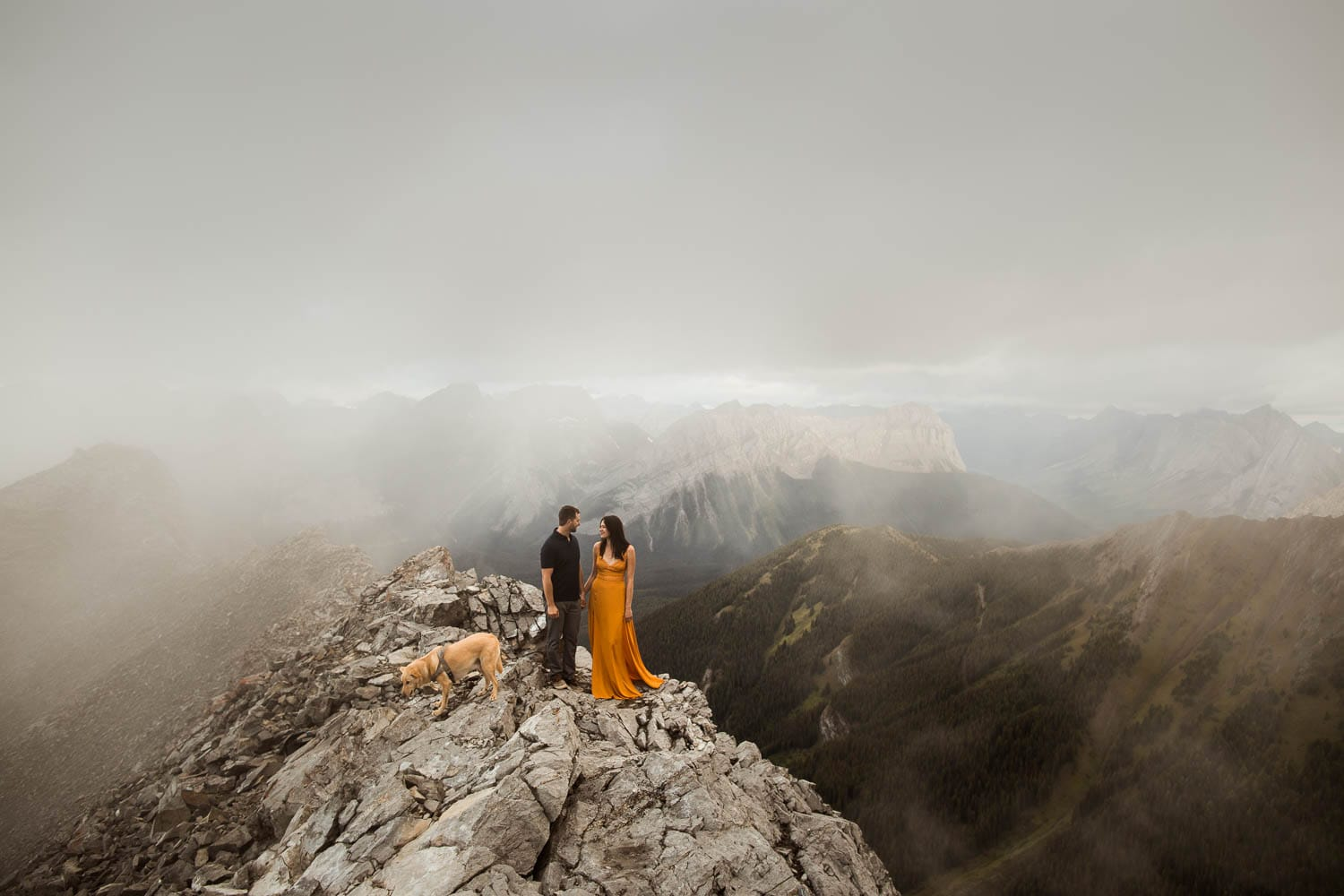 Couple and dog on mountain top