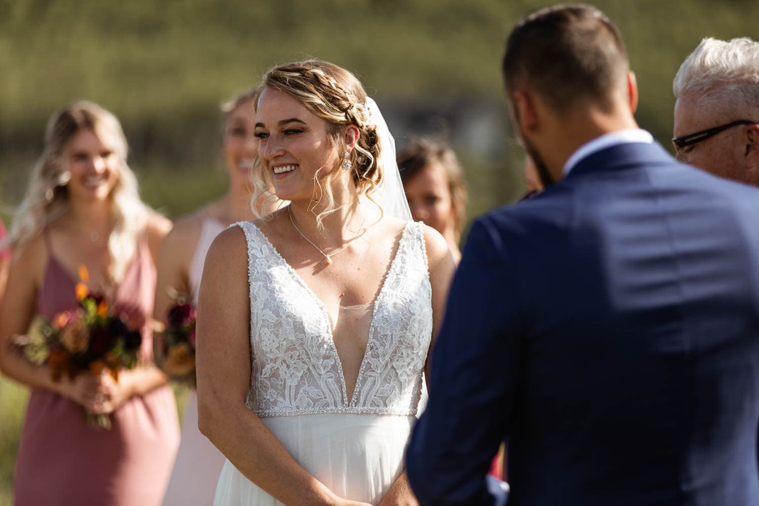bride laughing at wedding ceremony