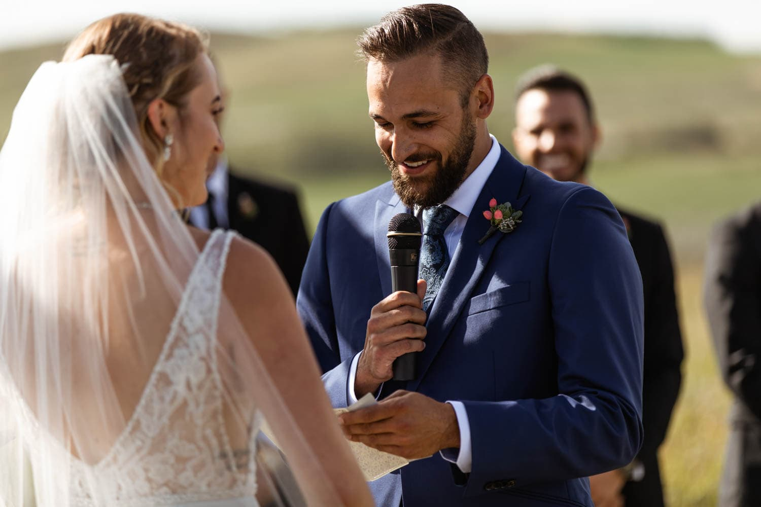 groom reading vows at wedding ceremony
