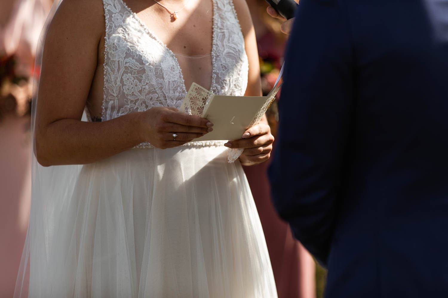 bride reading vows at wedding ceremony
