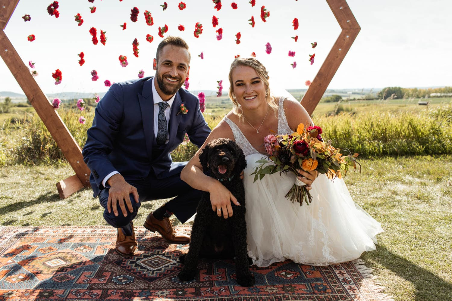 bride and groom portrait with dog