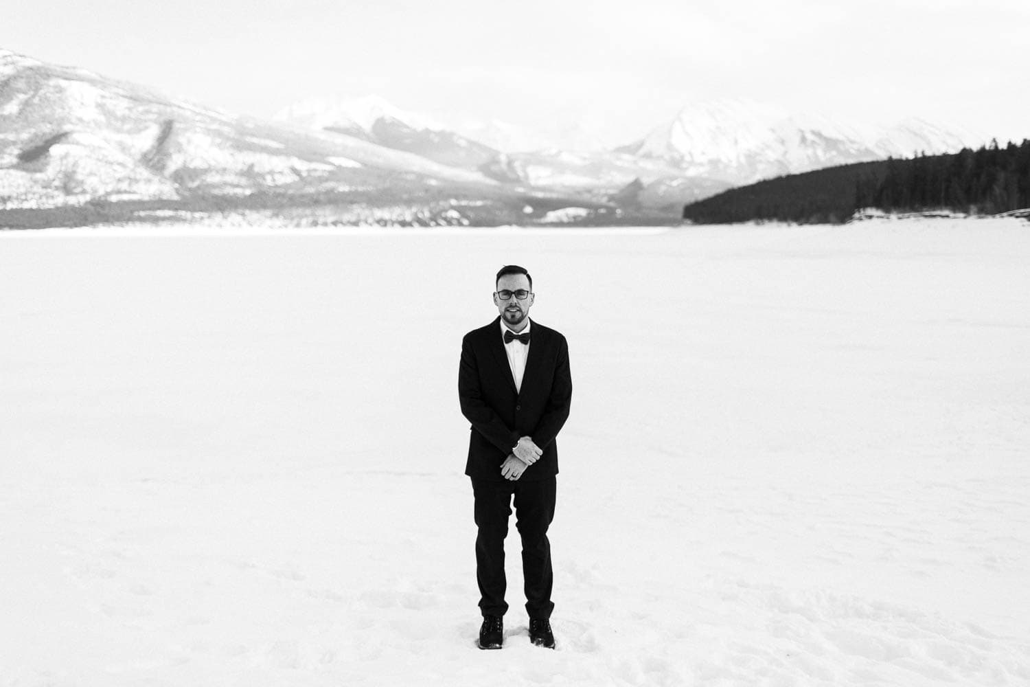 groom black and white winter wedding