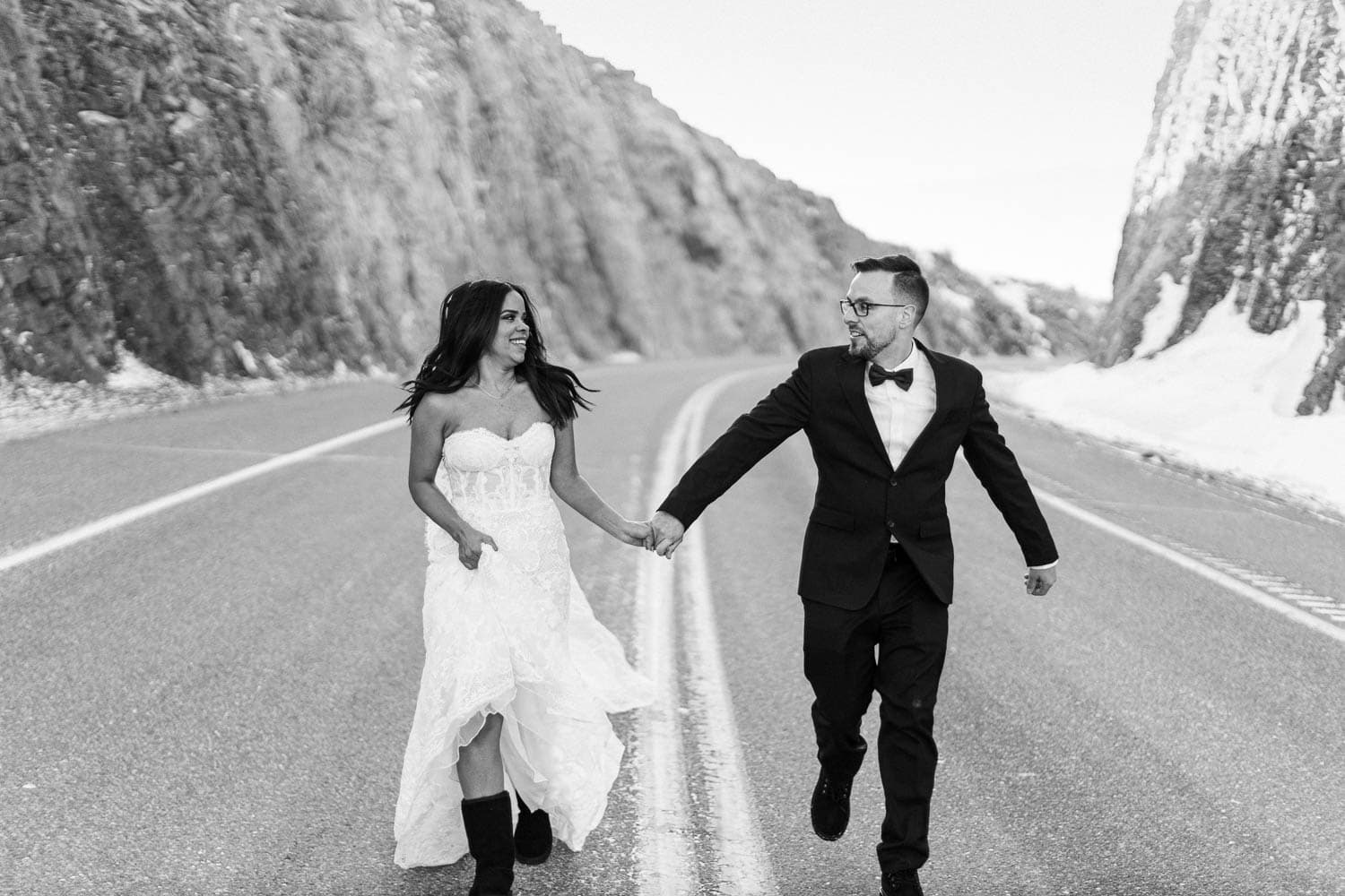 bride and groom running down road