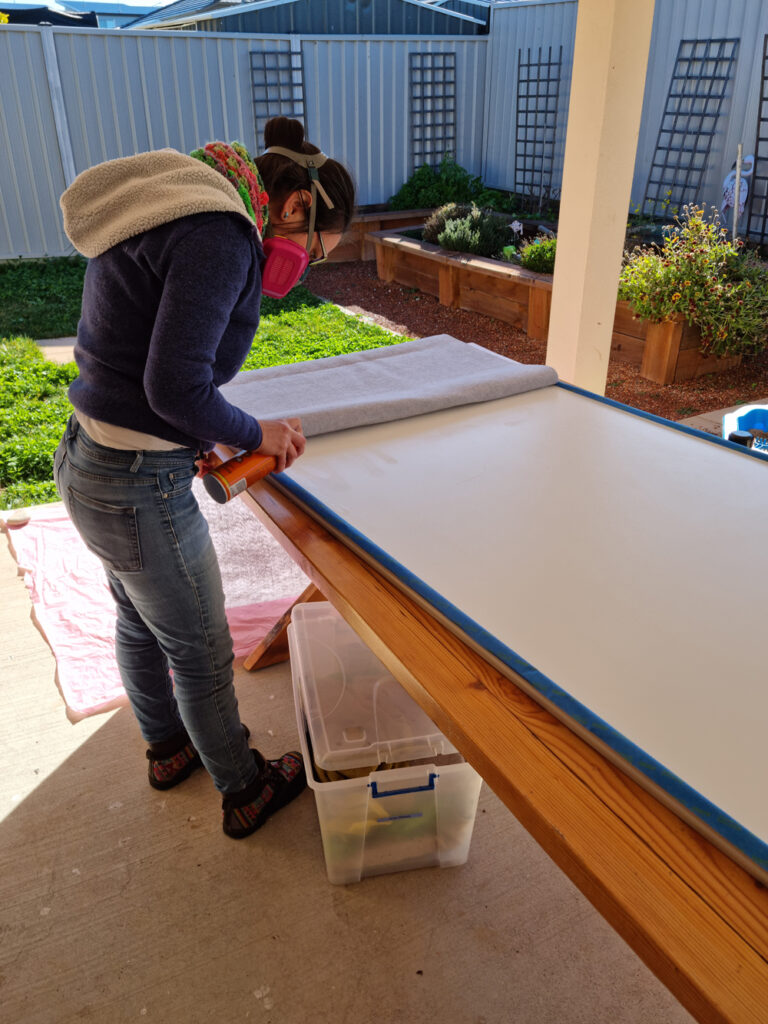 spray glueing the fabric to the door