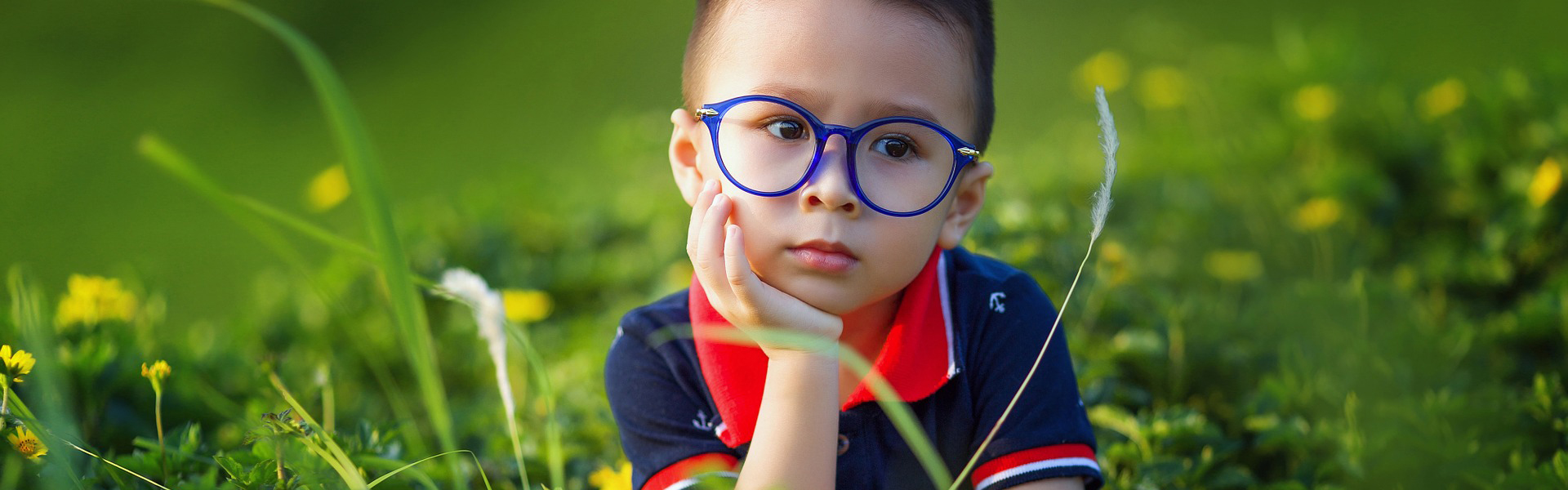 asian child wearing myopia glasses