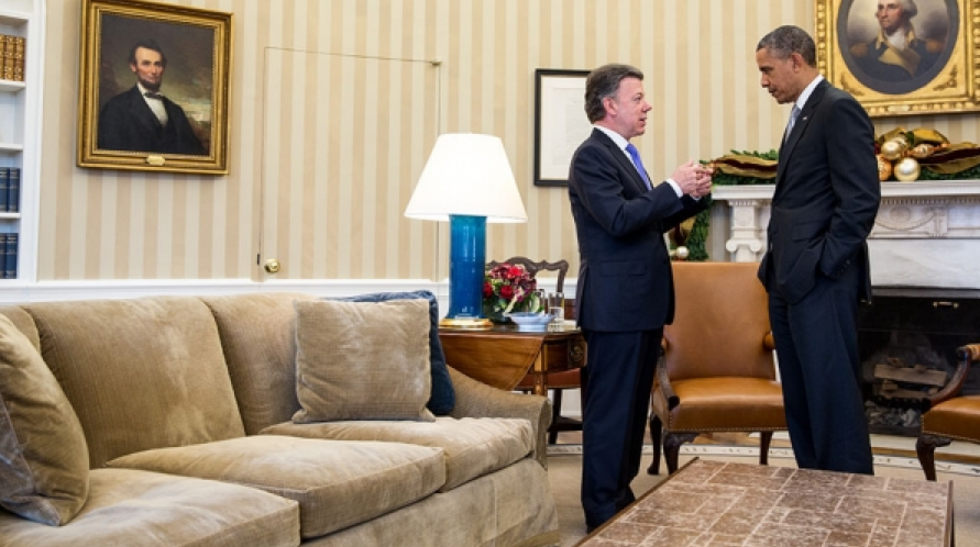 President Barack Obama talks with President Juan Manuel Santos of Colombia after their bilateral meeting in the Oval Office, Dec. 3, 2013. (Official White House Photo by Pete Souza)