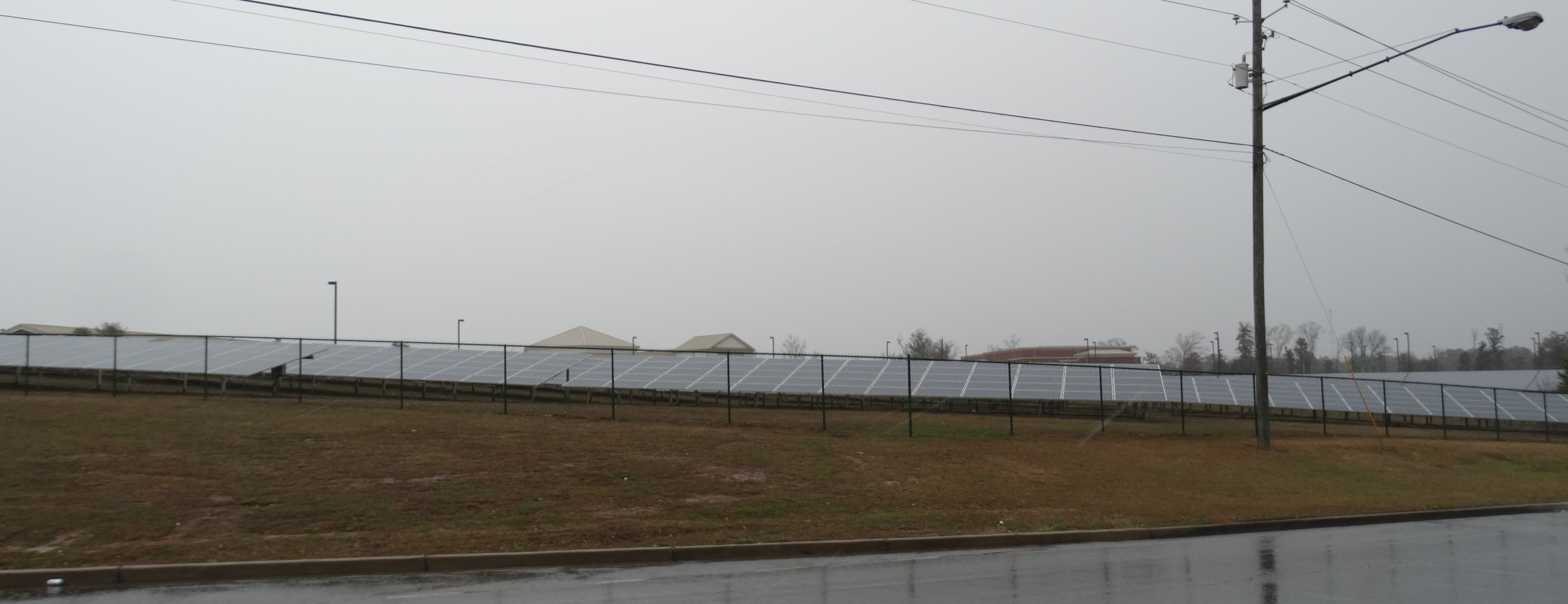 Solar panels are lined up in outside Dublin High School, where the groundbreaking ceremony took place two years ago this week for the 4,000-panel solar array on the high school campus.
