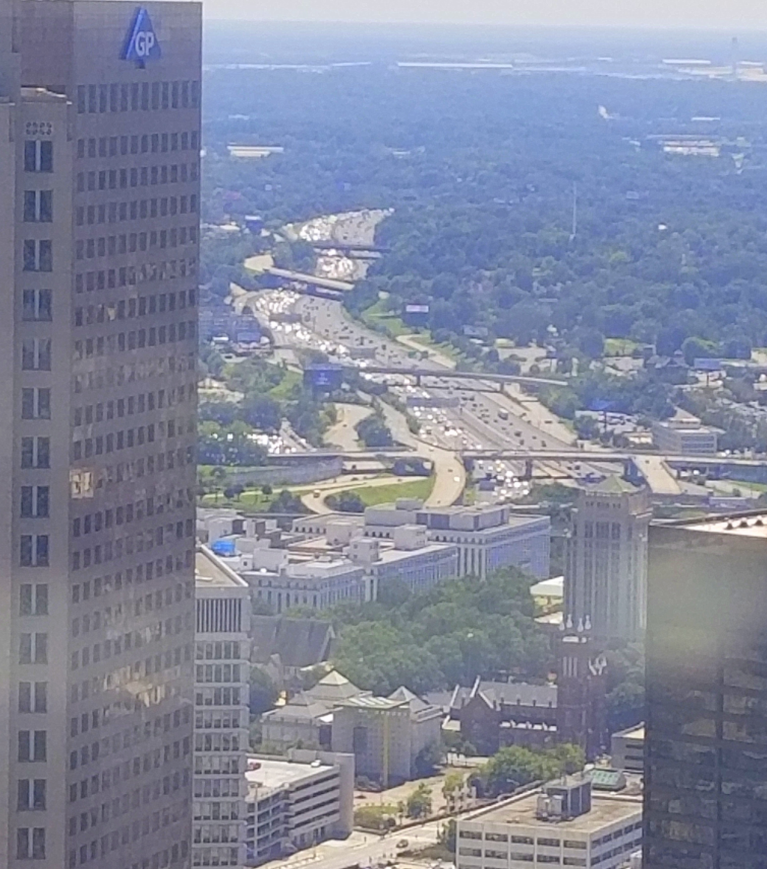 A river of headlights from vehicles crawling northbound on I-75 in Downtown Atlanta Thursday at noon highlights the danger Hurricane Irma poses as residents of Florida and Georgia headed inland in search of refuge and accommodation.