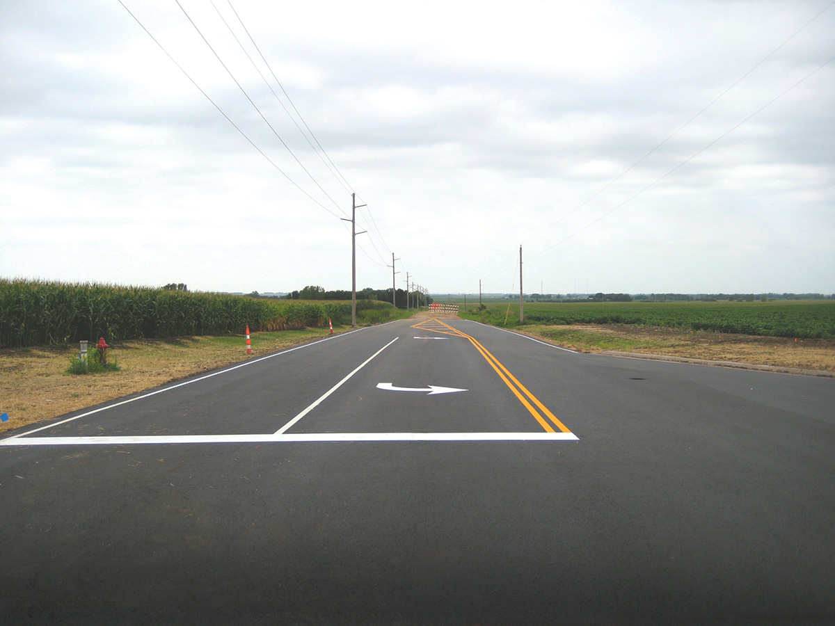 Resurfacing a public road and striping.