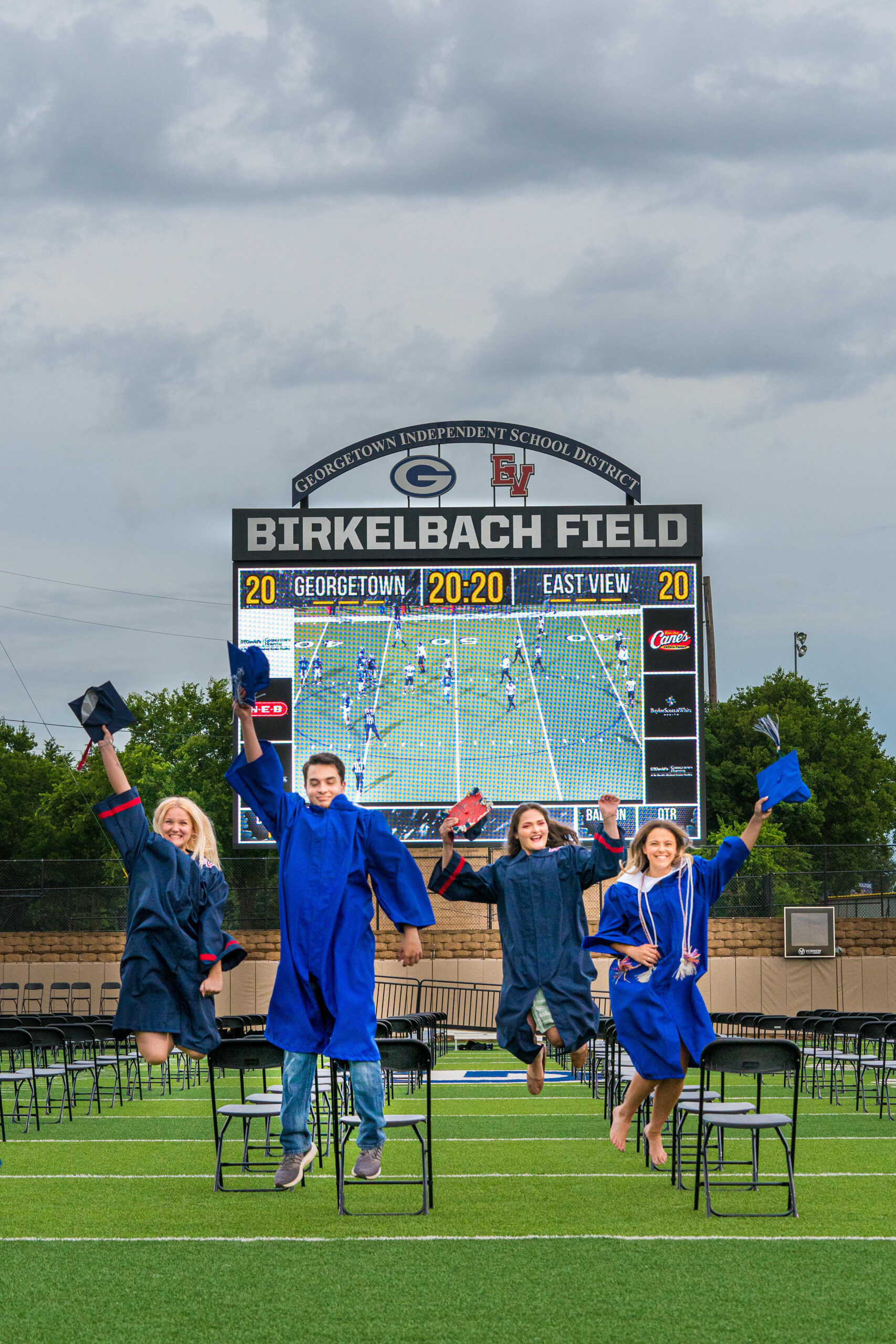 Georgetown and East View  High School seniors Kaylin Vrabel, Maverick Tomaszewski,  Jacky Meixsell and Taylor Wood celebrate their commencement at the GISD sports complex.  Graduations took place May 29-31. Photo by Rudy Ximenez