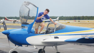 Even emerges with a triumphant fist pump after a flawless flight and smooth landing.