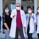 Group pic of medical providers in masks with thumbs up