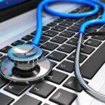 stethoscope lying on a computer keyboard