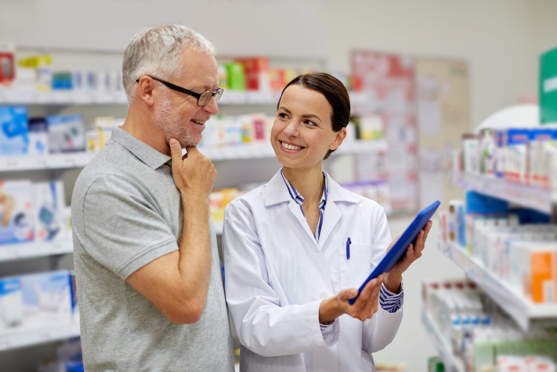 pharmacist with tablet pc and senior man