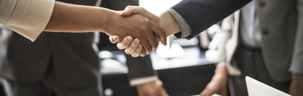 Standard Communications Inc staff shaking hand with new client