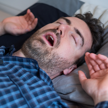 A Man Snoring in Bed