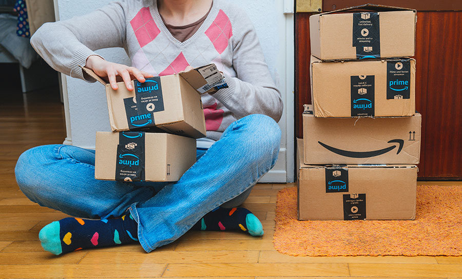 woman opening amazon prime packages