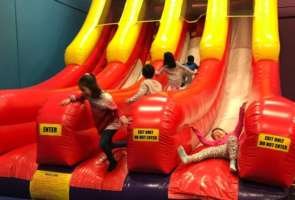 kids-on-inflatable-slide
