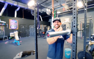 photo of titan up fitness owner talking about ego lifting standing at weight lifting station