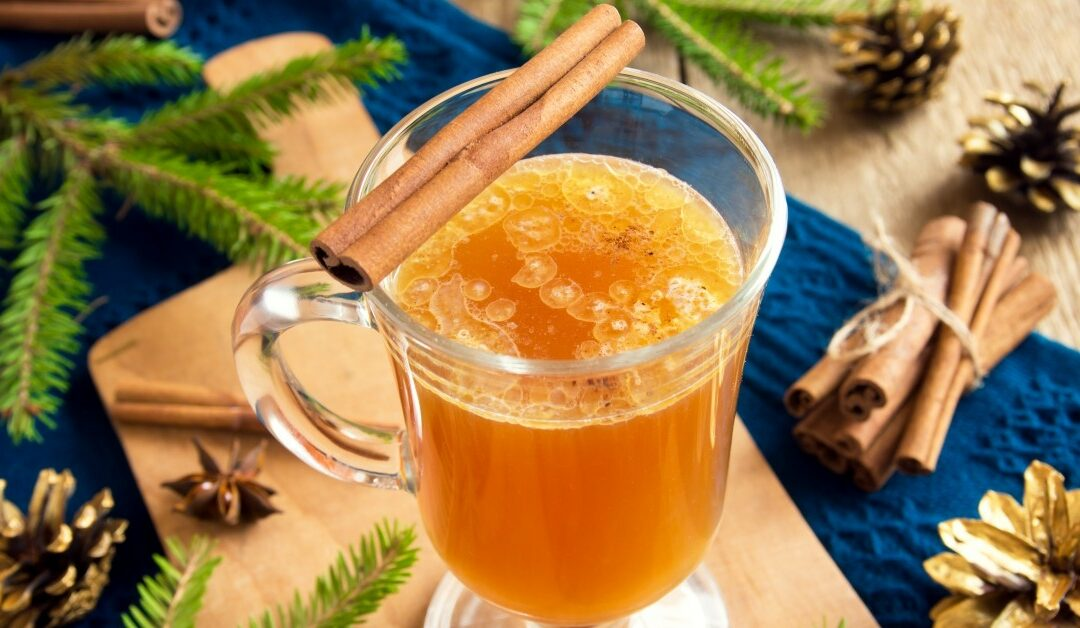 Image of a spiced orange drink with cinnamon.