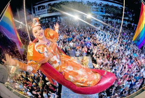 """Female impersonator Gary Marion, as """"Sushi,"""" dangles above New Year's Eve revellers in a giant replica of a woman's high heel at the Bourbon Street Pub complex in Key West, Florida, December 31, 2011. The Red Shoe Drop is a Key West tradition to celebrate the arrival of the new year. REUTERS/Andy Newman/Florida Keys News Bureau/Handout (UNITED STATES - Tags: SOCIETY ENTERTAINMENT TPX IMAGES OF THE DAY) FOR EDITORIAL USE ONLY. NOT FOR SALE FOR MARKETING OR ADVERTISING CAMPAIGNS. THIS IMAGE HAS BEEN SUPPLIED BY A THIRD PARTY. IT IS DISTRIBUTED, EXACTLY AS RECEIVED BY REUTERS, AS A SERVICE TO CLIENTS ORG XMIT: KWP06"""