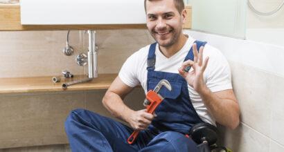 cheerful-plumber-gesturing-ok_23-2147772212