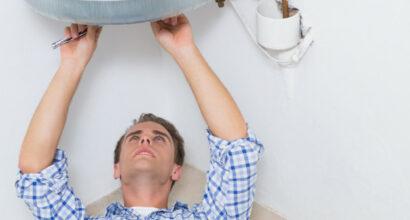 technician-servicing-hot-water-heater_13339-293383 (1)