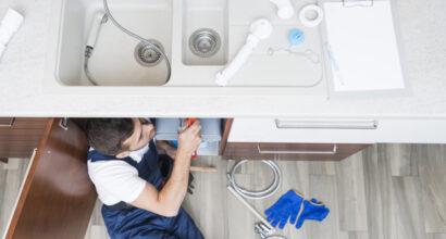 worker-lying-kitchen-sink_23-2147772254