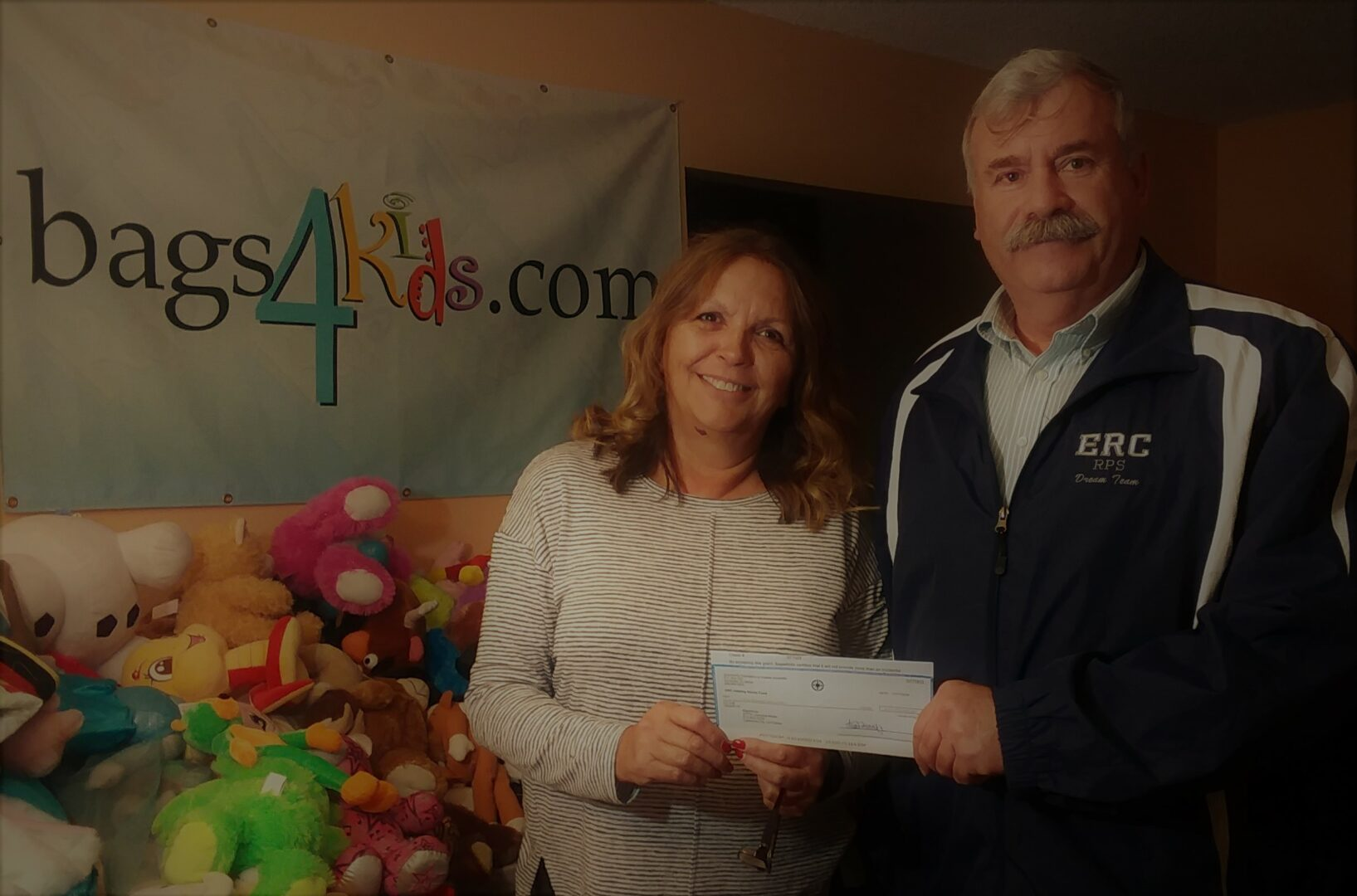 LaJuana Moser donating a check to Bags4Kids