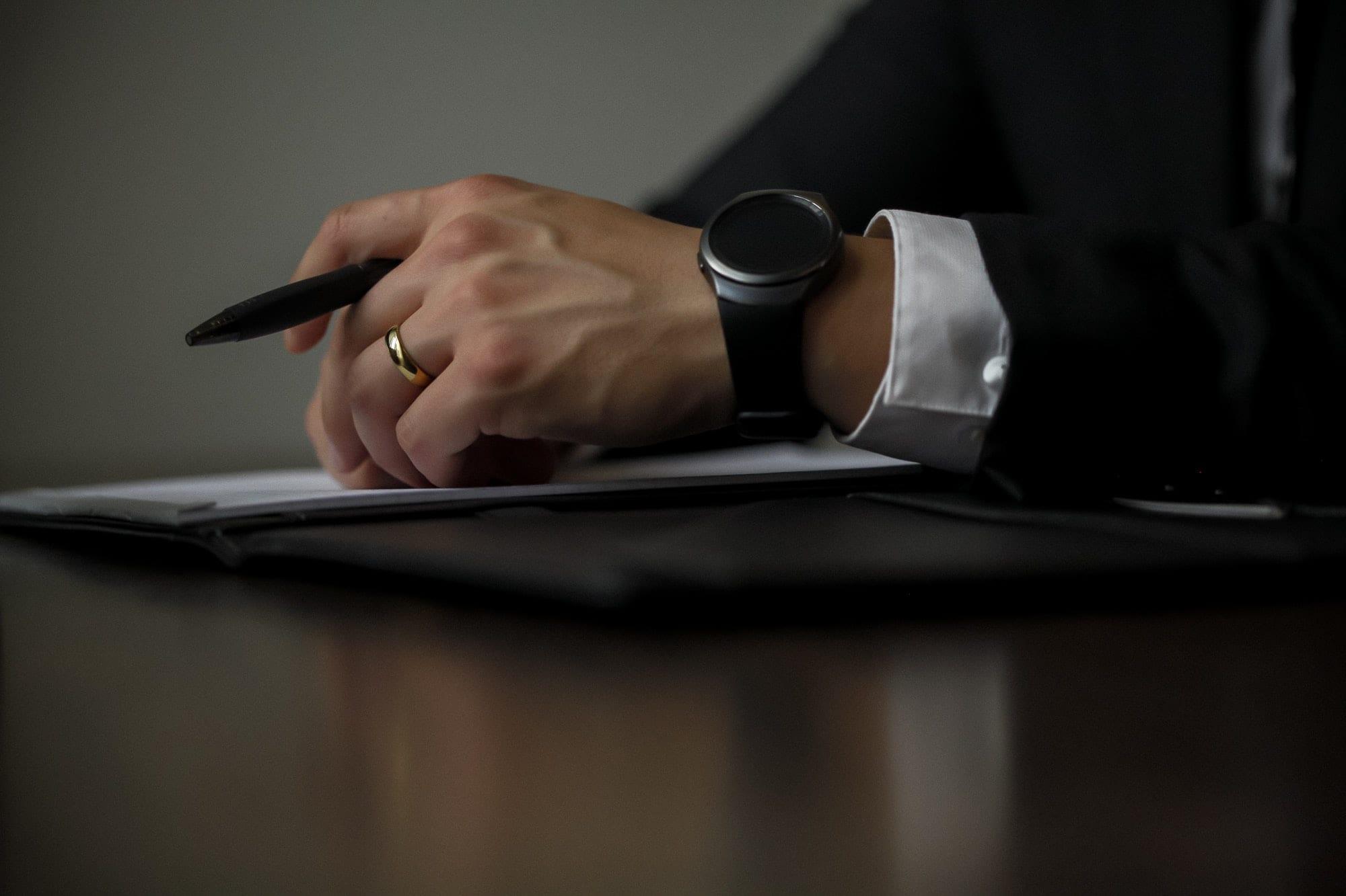 person holding a pen - legal case