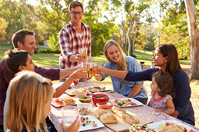 group of people sharing cheers at a picnic