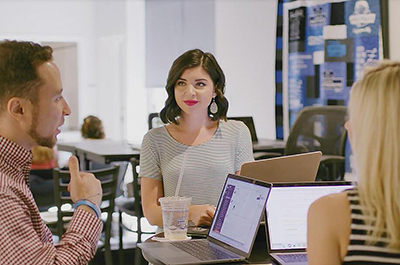 coworkers sitting together in a meeting