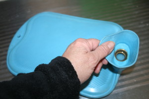 Fill hot water bottles safely. Flat, to expel air.
