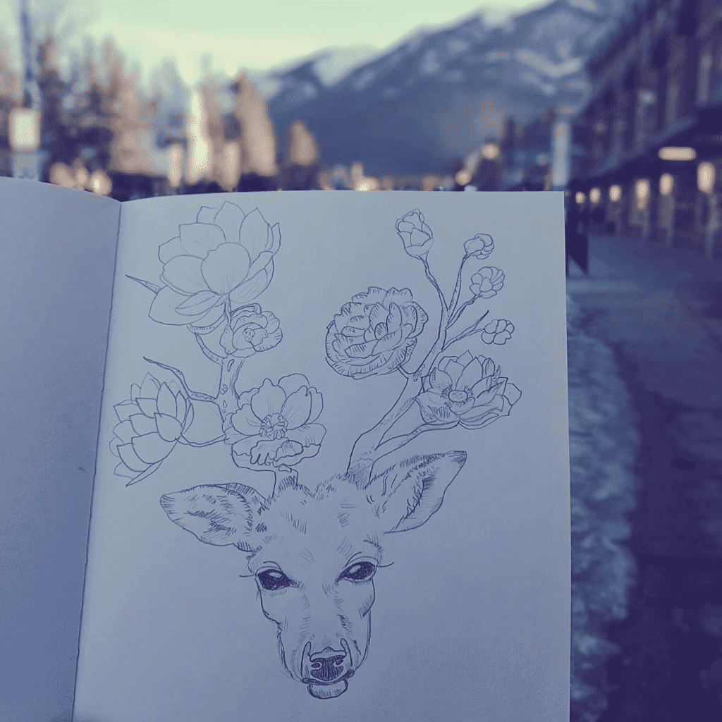 A pencil drawing of a deer with flowers branching out as it's antlers