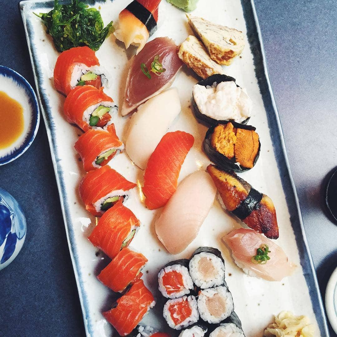 sushi platter of sashimi nigiri and sushi rolls