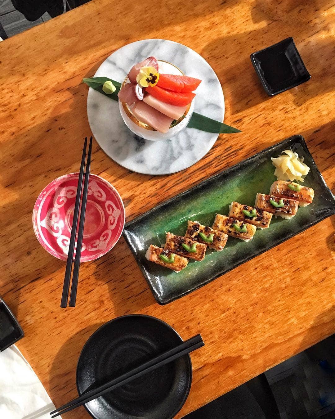 Oshi aburi sushi and plates and sashimi