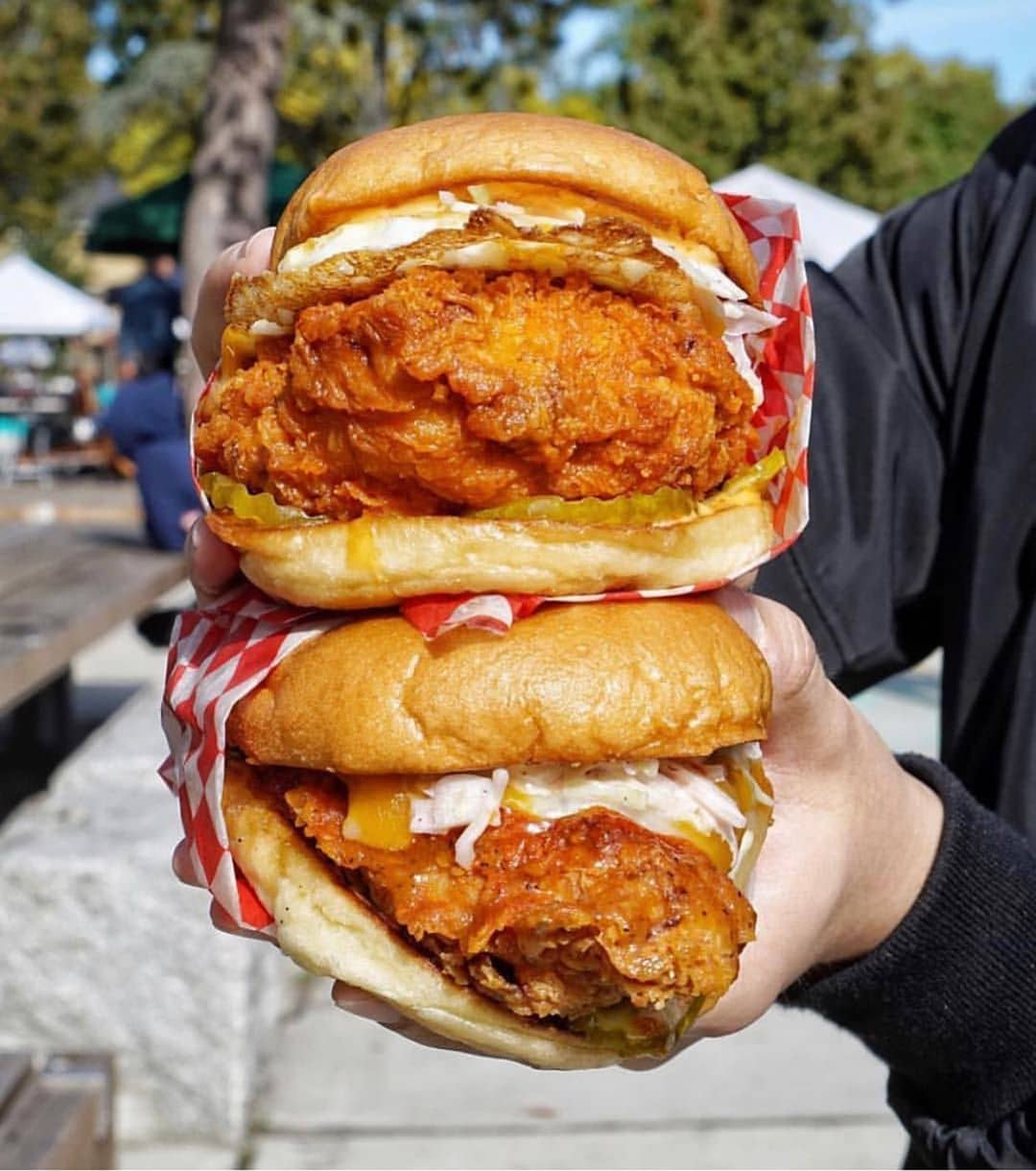 two fried chicken sandwiches held together