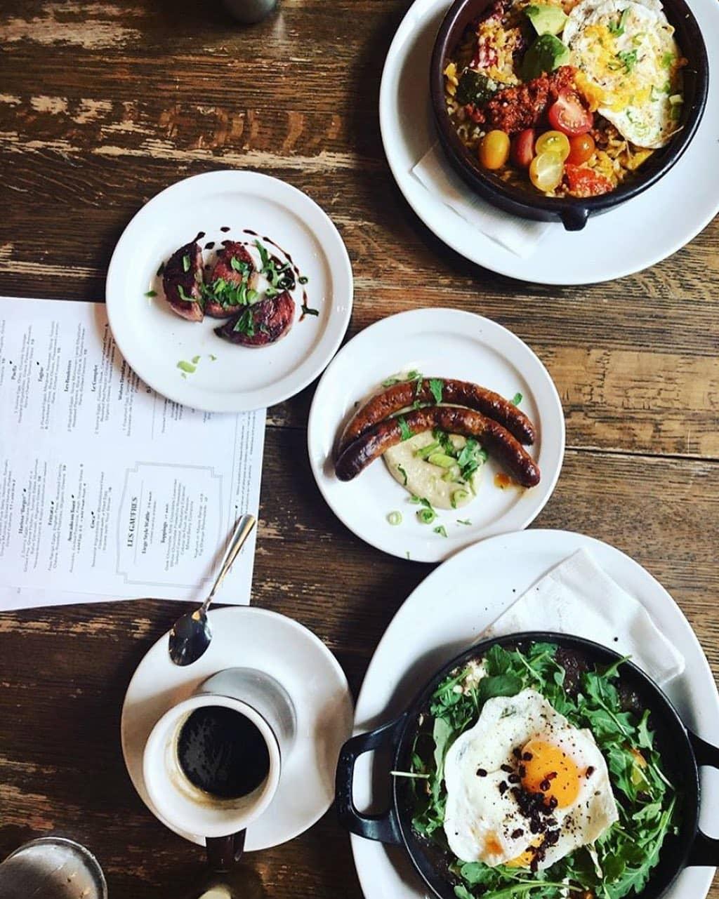 egg benedict brunch plates wooden table