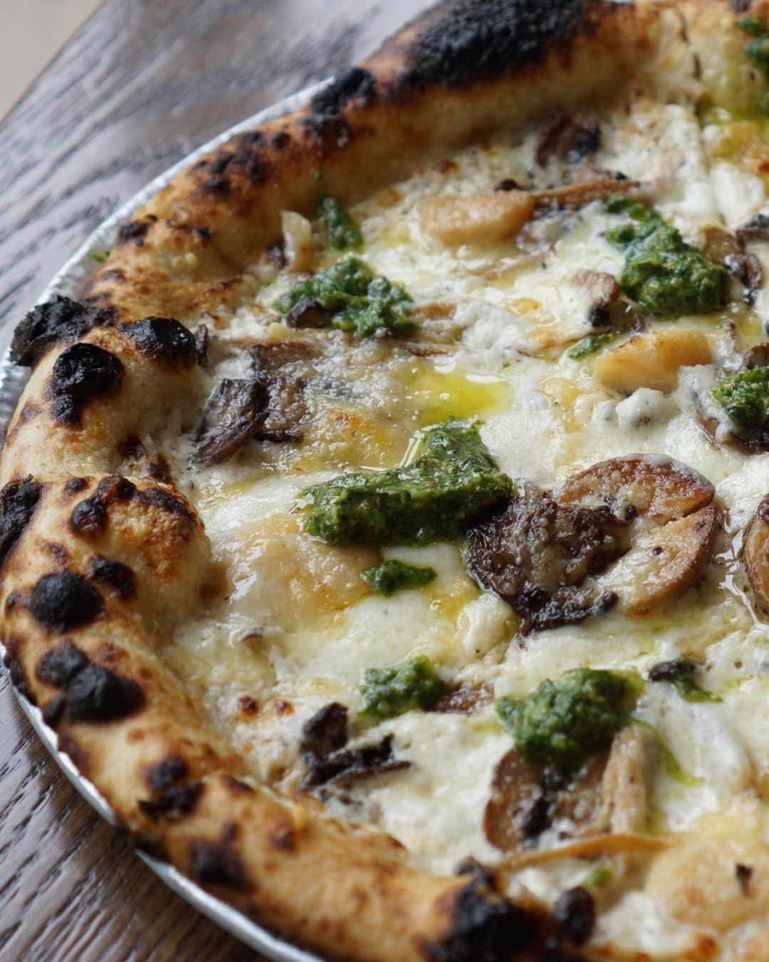 mushroom pizza on wooden table