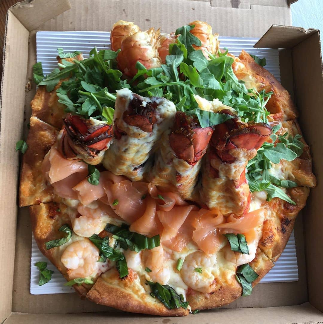 Serpent pizza with lobster tails smoked salmon and shrimp