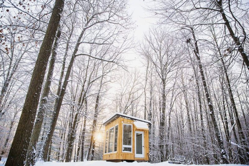 coolest airbnb canada - the cabin at fernwood hills exterior in forest during winter