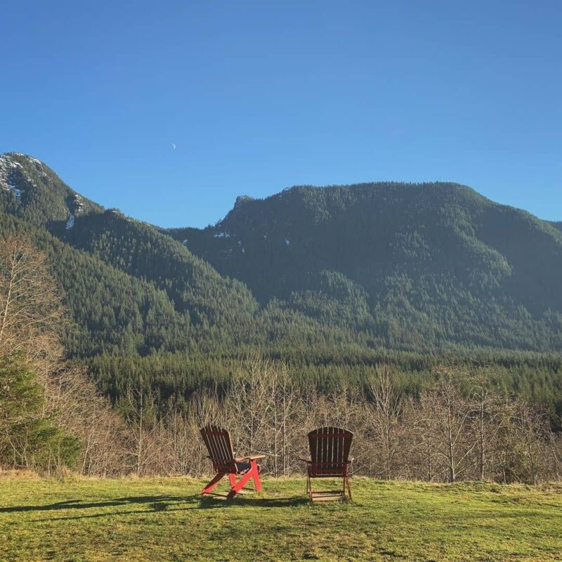 Things to Do in Vancouver When You're Low on Budget -lower seymour conservation two red chairs among mountain view