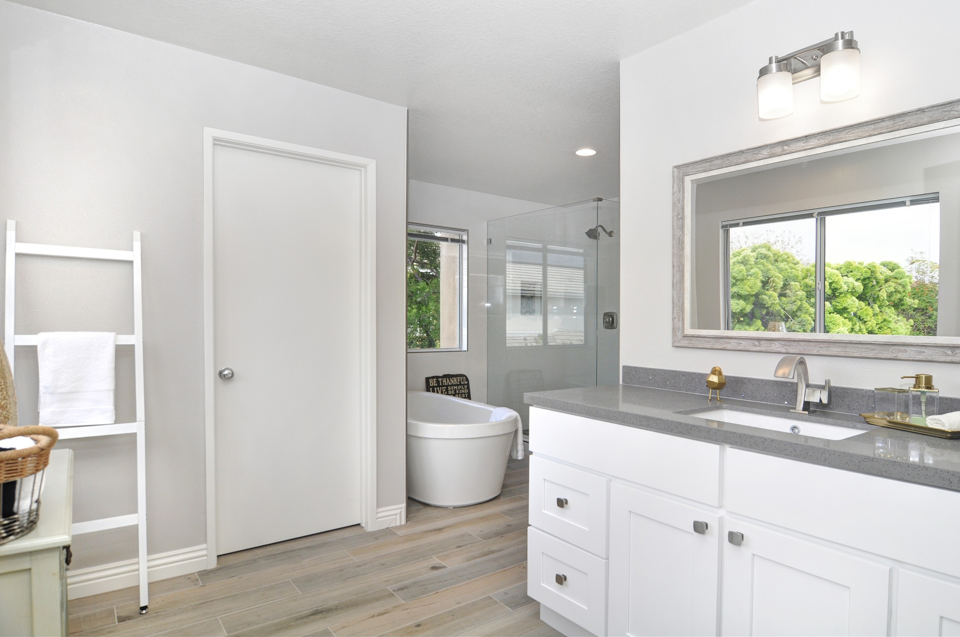 Remodeled bathroom in white and gray on the One Stop Plumbing page for Plumbing Remodeling